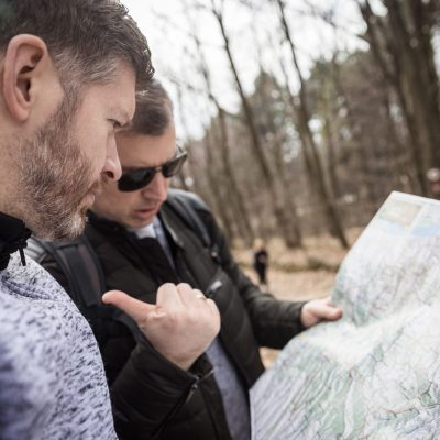 Men trying to find direction on the map